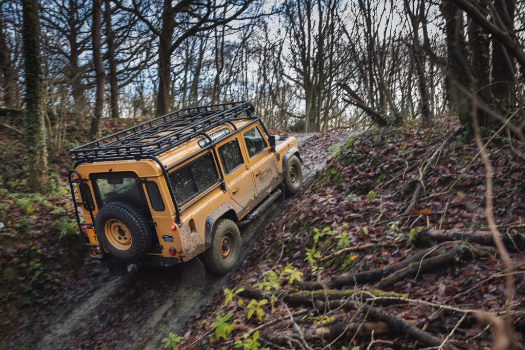 An image of a Land Rover Defender Trophy V8 off-roading.