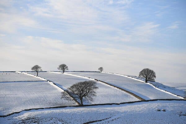 """Snow-covered fields near Tideswell, England, on Thursday. The """"Great Frost"""" of 1709 caused Britain's economy to shrink 13 percent."""