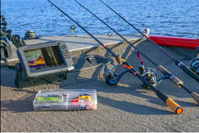 Three fishing rods with fish finder